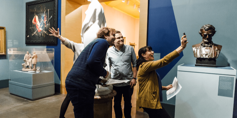 A team engages with the art on a Museum Hack tour.